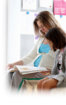 image of a mother and daughter reading a book
