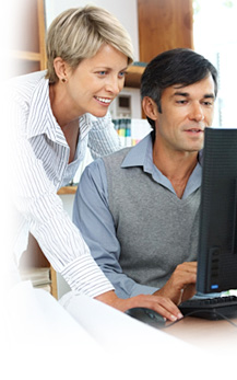 image of two people looking at a computer